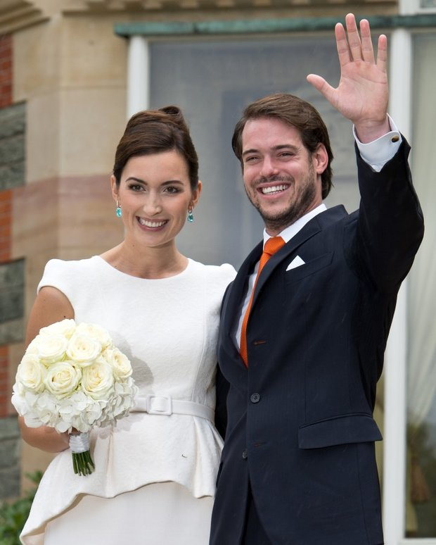 Prince Felix of Luxembourg and his wife Claire Lademacher pose for the media in front of hotel Villa Rothschild Kempinski after their civil wedding in Koenigstein, Germany, Tuesday Sept. 17, 2013. The church wedding will take place in France on Sept. 21, 2013. Prince Felix Leopold Marie Guillaume of Luxembourg is the second son of Grand Duke Henri and Grand Duchess Maria Teresa. (AP Photo/dpa,Roland Holschneider)