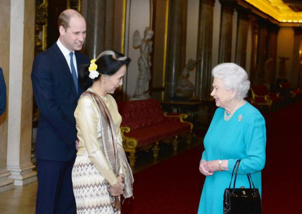 Britain's Queen Elizabeth and the Prince William greet Burma's de facto leader Aung San Suu Kyi ahead of a private lunch at Clarence House in London