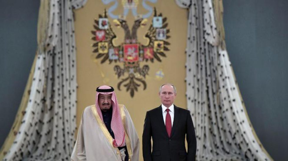 Russian President Vladimir Putin and Saudi Arabia's King Salman attend a welcoming ceremony ahead of their talks in the Kremlin in Moscow