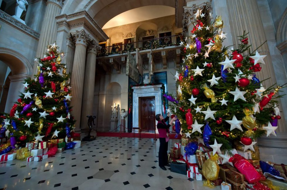 Twinkling Christmas trees in the Great Hall at Blenheim Palace