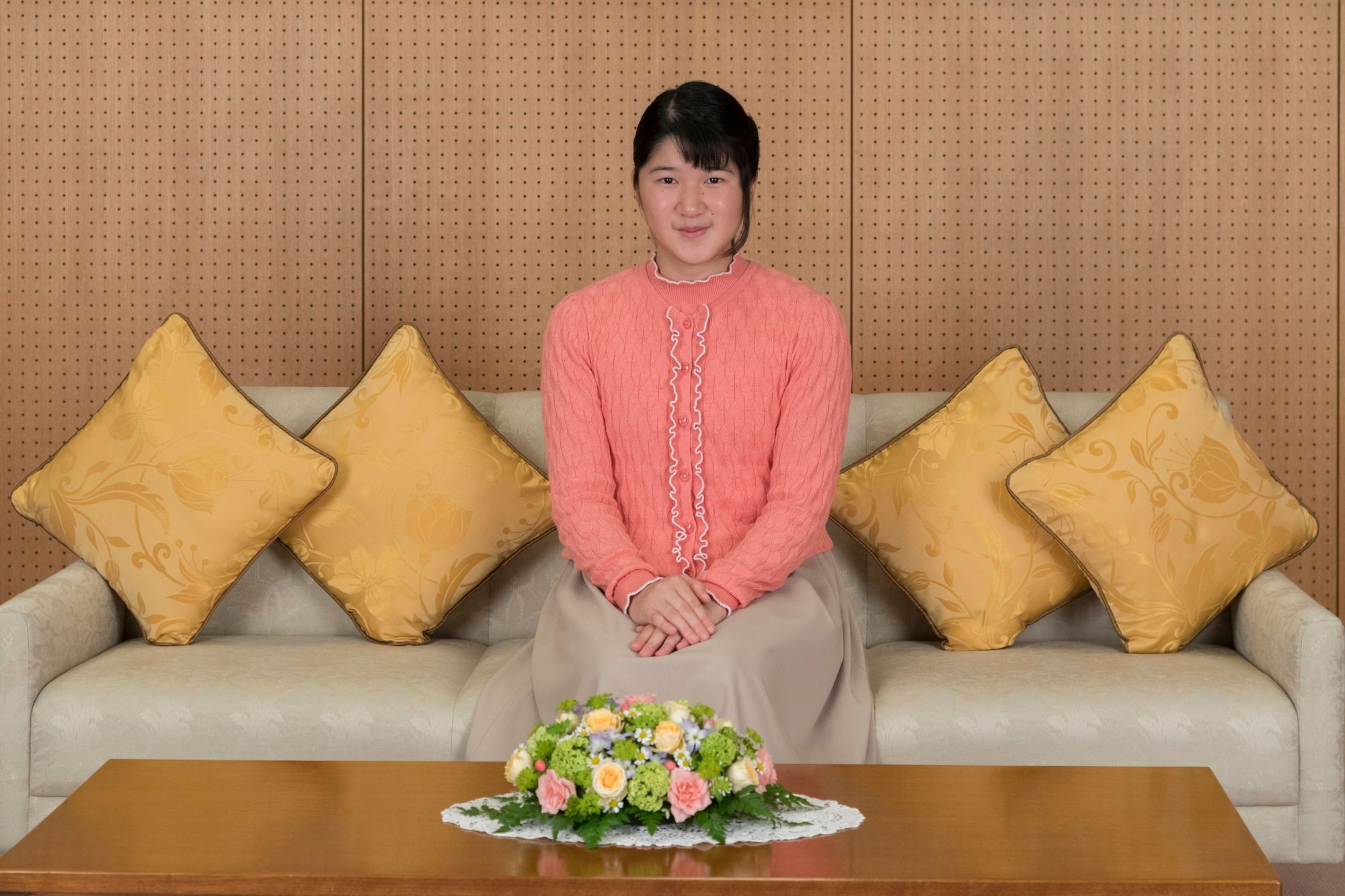 Japan's Princess Aiko talks with her father Crown Prince Naruhito about her school trip at Togu Palace in Tokyo, Japan, in this handout photo
