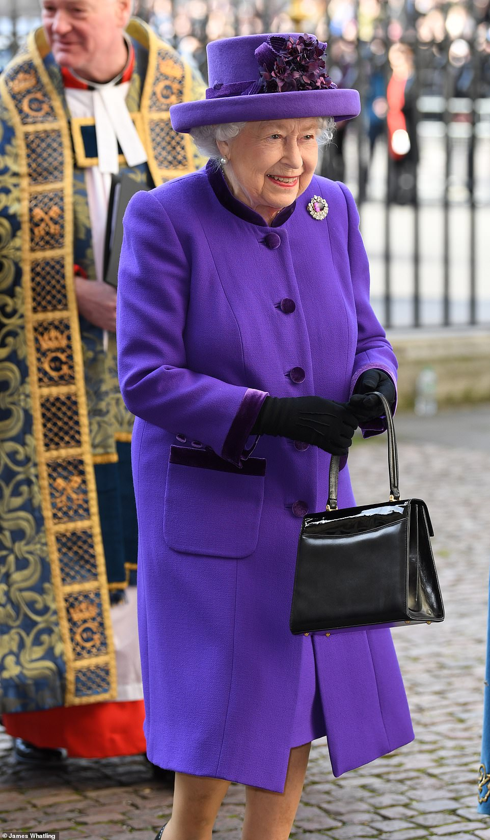 10840522-6795345-The_Queen_opted_for_a_bold_purple_ensemble_as_she_donned_a_match-m-83_1552317775188