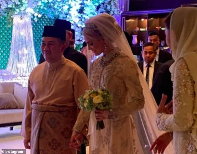 12516768-6942687-Louise_Johansson_looks_joyful_as_she_marries_Malaysian_Crown_Pri-m-47_1555790239077