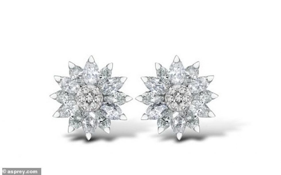 25484176-8070071-The_glitzy_daisy_earrings_which_come_with_a_pricetag_of_17_300_a-a-42_1583249721278