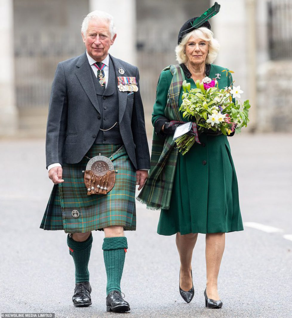 28155874-8300507-Camilla_72_joined_her_husband_Prince_Charles_71_to_lay_flowers_a-a-81_1588938401986