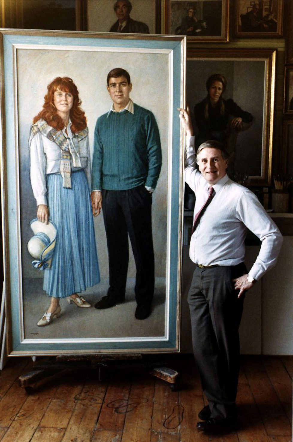 Michael Noakes Royal portrait painter standing in front of his portrait of the Duke and Duchess of York 1988